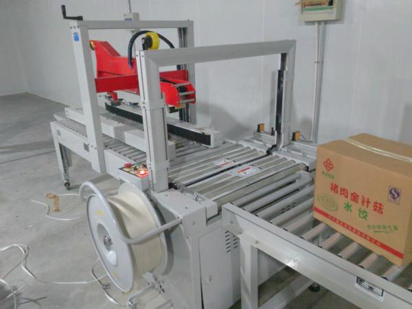 沈阳某食用菌工厂采购全自动折盖封箱打包一体机